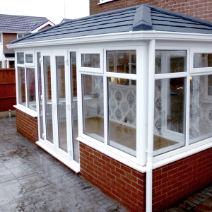 Solid Conservatory roofing with white upvc finish and french doors
