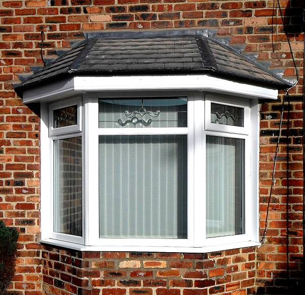 Bay Glass window with white upvc finish and decorative glass