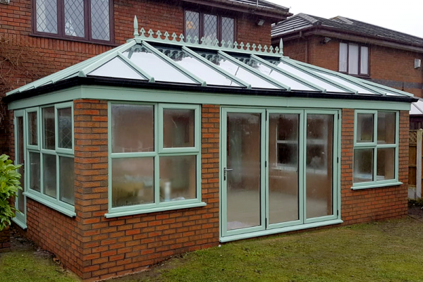 Chartwell Green conservatory with glass roof and bi fold doors