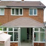 Designer conservatories with solid tiled roof