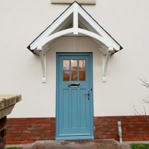 Pitched door canopies with solid tile roof