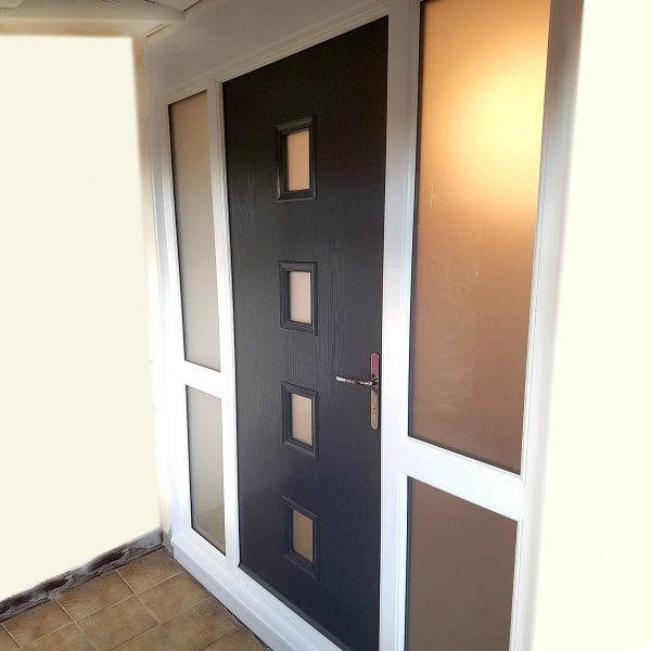 Black door with espirit style and four panes of glass