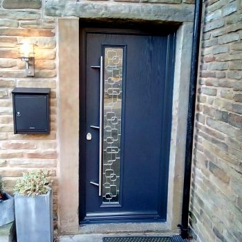 Anthracite colour doors with silver bar and canvas glass