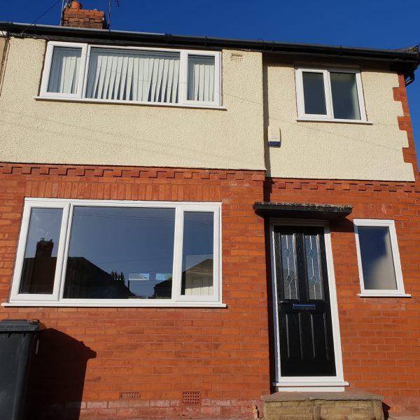 Door and Window suppliers white uPVC frames and black door
