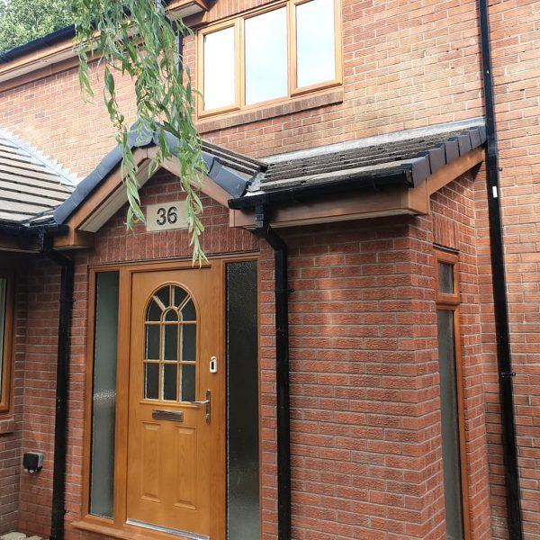 Oak brown door and window installation