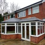 P shape conservatory with solid roof and french doors