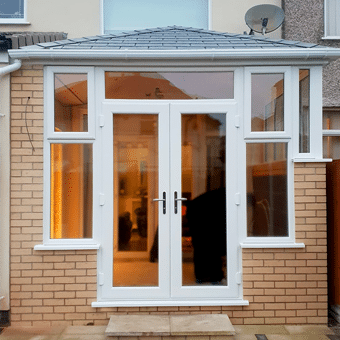 Solid Roof Orangery With White uPVC French Doors