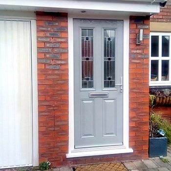 light grey doors with aspen glass and silver finish