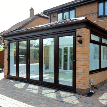 Edwardian Conservatory with glass roof and bi folding doors
