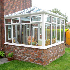 glass extension with half brick base and white upvc double glazing