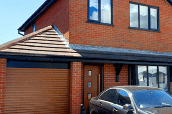 Oak Brown Doors and windows with anthracite grey frames