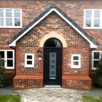 arched doorway with black composite door